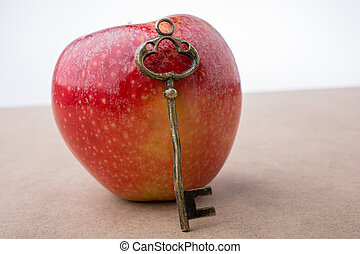 accanto, mela, chiave, tenendo mano