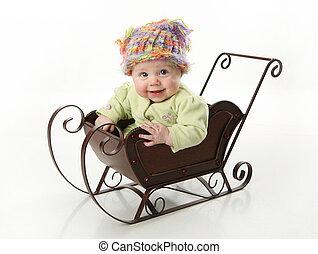 bambino sorridente, slitta, seduta