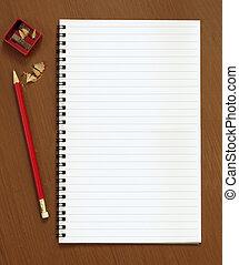 blocco note, affilatrice, matita