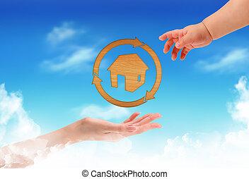 casa blu, cielo, mano femmina