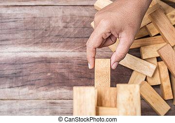 concetto, blocchi, rischio, mano legno, fondo., gioco, legno, presa a terra, (jenga), asse