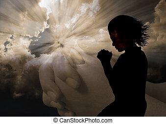 donna pregando, silhouette