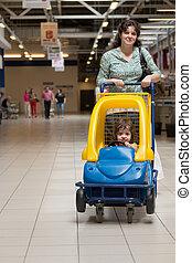 donna, supermercato, bambino