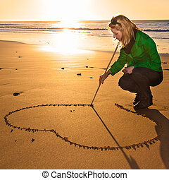 drowing, forma cuore, donna, sand.