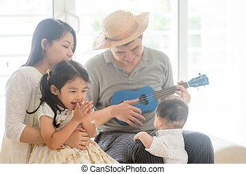 famiglia, asiatico, ukulele, gioco