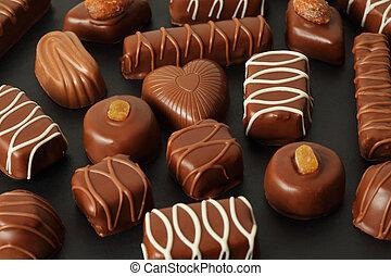 glassa, molti, cioccolato, scuro, candys, fondo, appetitoso