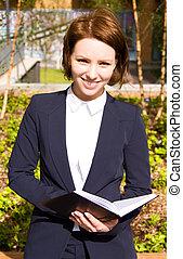 holding donna, affari, giovane, diary.