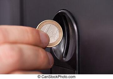 inserire, moneta, mano umana