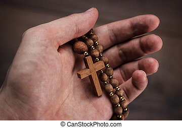 mano legno, fuoco, croce
