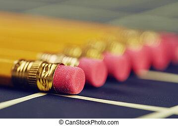 matite, cancellatori, lato