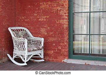 mattone, sedia vimini, bianco rosso