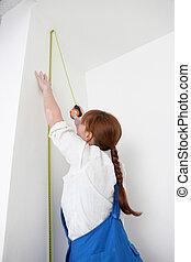 misurazione, parete, donna