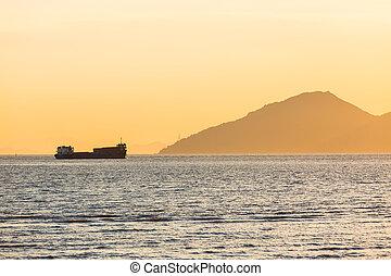 nave carico, tramonto, navigazione