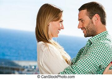 outdoors., abbracciare, coppia, giovane