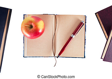 penna, quaderno, mela
