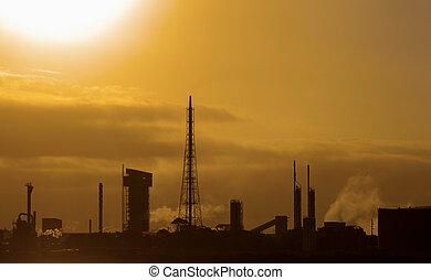 raffineria, tramonto