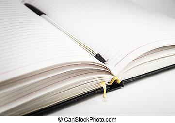 segnalibro, penna, quaderno, aperto