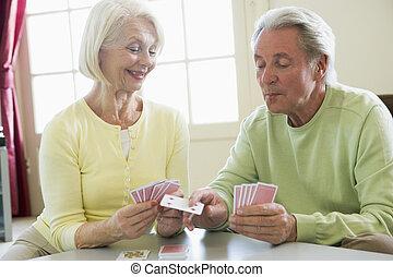 soggiorno, coppia, cartelle, sorridente, gioco