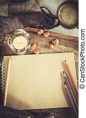 tazza caffè, carta, quaderno, plaid, candela