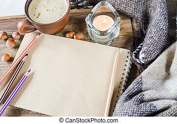 tazza caffè, quaderno, plaid, candela, vuoto