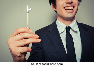 uomo affari, giovane, chiave, felice