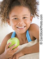 vivente, mela mangia, giovane, ragazza sorridente, stanza